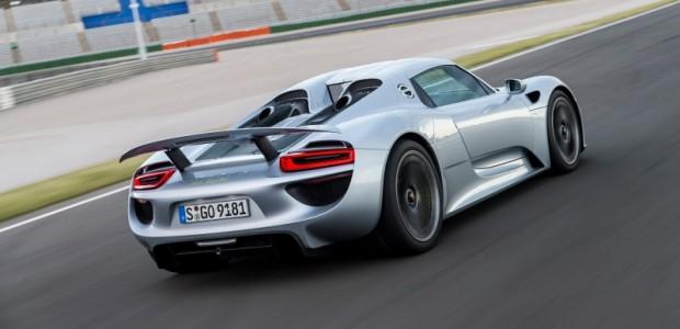 2015-porsche-918-spyder-rear-three-quarter-in-motion-06